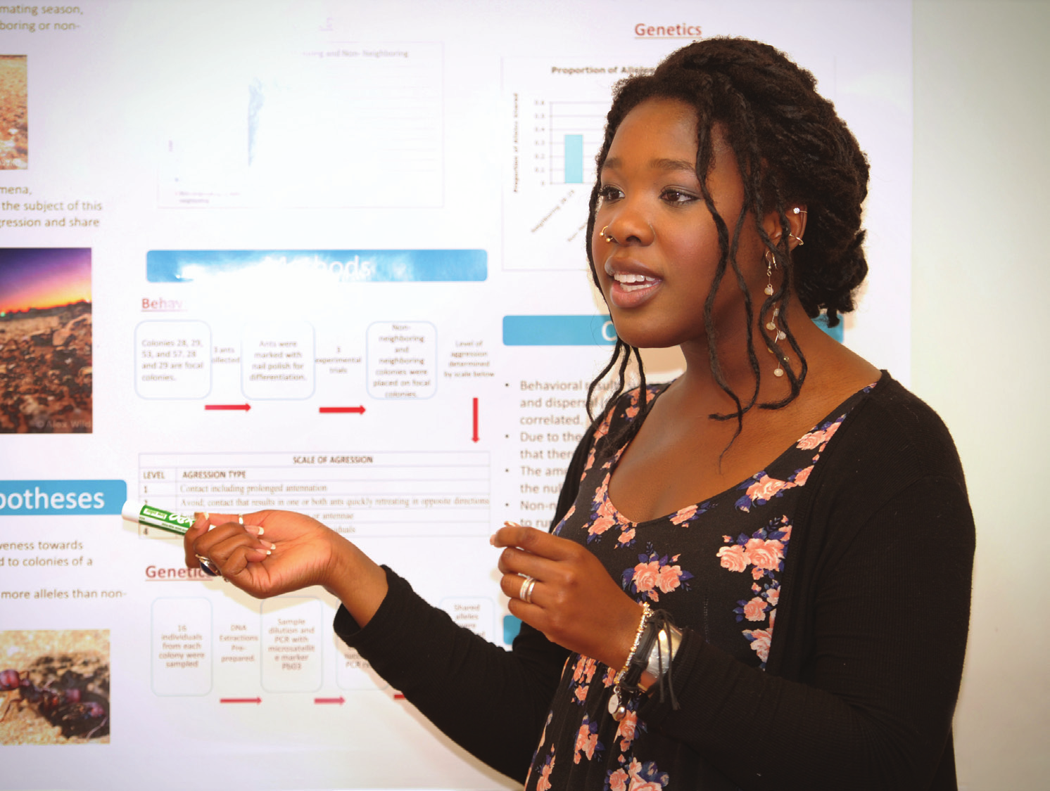 NMSU biology student Linner Itauh presents her research poster during the lab component of an NMSU-HHMI un- dergraduate guided biological research class in Foster Hall. The 2015 class is taught by biology professor Tim Wright.