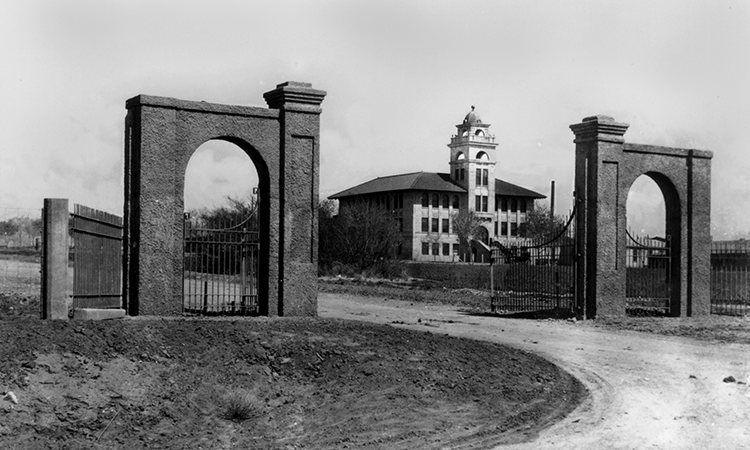 Goddard Hall as seen through the old gates of Miller field.